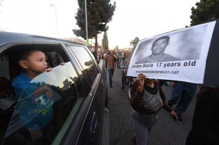Protestors march November 25, 2014 in Los Angeles, one day after a grand jury decision not to prosecute a white police officer for the killing of an unarmed black teen in Ferguson, Missouri. Robyn Beck/AFP/Getty Images