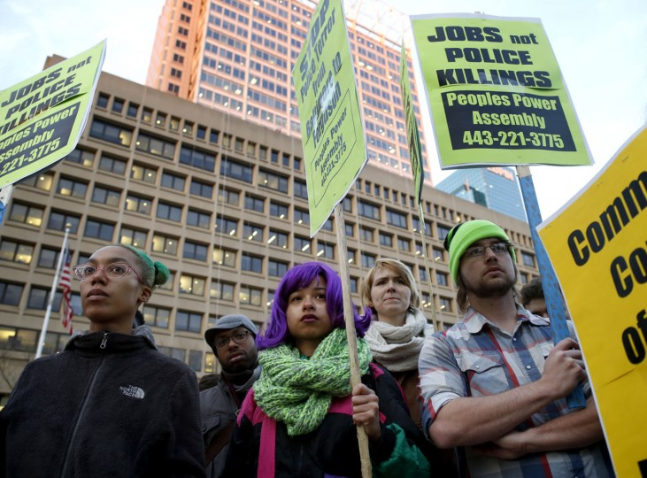 Chanel Cruz, Michael Franklin, Christianna Clark, Niki Murphy and Patrick Taylor stand in protest against the grand jury decision to not indict Ferguson police officer Darren Wilson at McKeldin Square near the Inner Harbor. Cassidy Johnson/Baltimore Sun