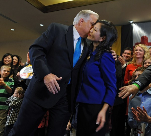 Maryland Governor-elect Larry Hogan, a Republican, kisses his wife Yumi after his victory speech at his campaign headquarters on election night. (Kenneth K. Lam/Baltimore Sun)