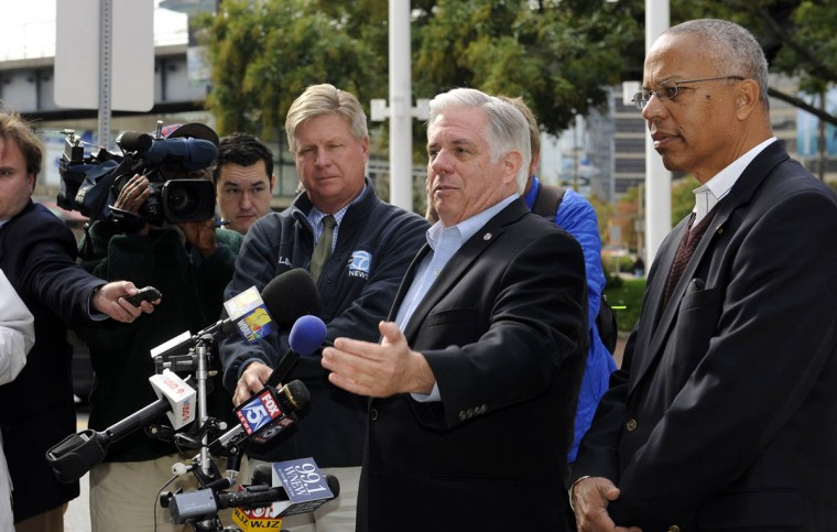 Republican gubernatorial candidate Larry Hogan (gesturing) and his running mate Boyd Rutherford, on right, hold a press conference near the Inner Harbor this afternoon. (Barbara Haddock Taylor, Baltimore Sun)