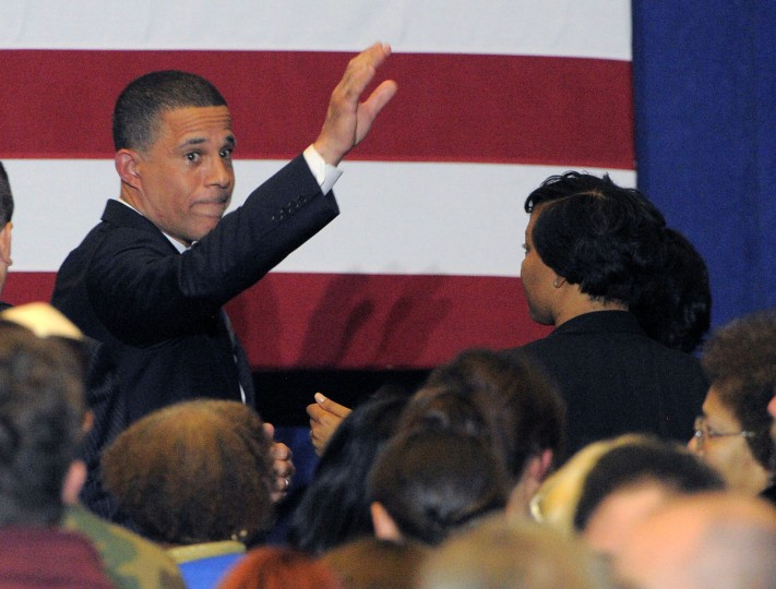 Gubernatorial candidate Anthony Brown (D-Md.) waves a final time to the crowd after conceding to Republican victor Larry Hogan at the Brown/Ulman election night party at the University of Maryland Wednesday. (Karl Merton Ferron / Baltimore Sun)