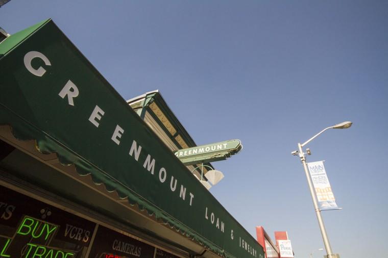 Shops along Greenmount Avenue, a boundary of Waverly. (Kalani Gordon/Baltimore Sun/Nov. 2014)