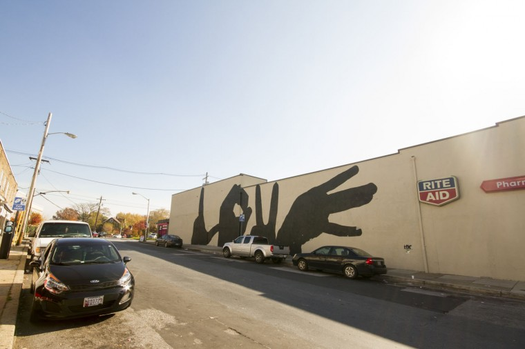 One of the city's LOVE murals, on the side of the Rite Aid pharmacy building in the 3100 block of Greenmount in Better Waverly. (Kalani Gordon/Baltimore Sun/Nov. 2014)