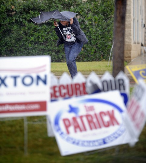 Voters brave wind and driving rain at the polling site at the Tarrant County Southwest Sub-Courthouse in Fort Worth, Texas, on Tuesday, Nov. 4, 2014. (Max Faulkner/Fort Worth Star-Telegram/MCT)