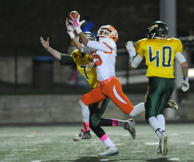 Fallston receiver Niko Rice pulls in the ball and makes the catch as North Harford's Evan Siegel tries to knock it away on a pass play in Friday night's game at North Harford. (Matt Button/BSMG)