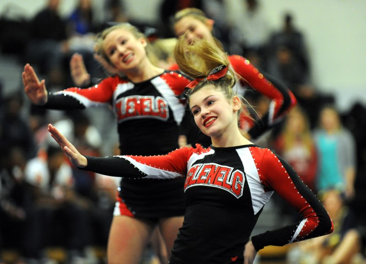 Glenelg freshman Sarah Cooper dances with fellow squad members during the Fall 2014 Howard County Varsity Cheerleading Competition at Oakland Mills High School on Thursday, October 30. (Brian Krista/BSMG)
