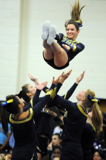 Oakland Mills junior Bailey Johnson and fellow cheerleaders perform their routine during the Fall 2014 Howard County Varsity Cheerleading Competition at Oakland Mills High School on Thursday, October 30. (Brian Krista/BSMG)