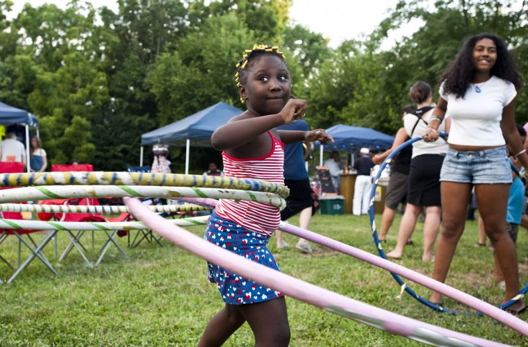 7/26/13: Kayla Keith, 7, hula hoops at the WAVEScape festival, held at the 30th St. Park in Waverly, during National Night Out, Friday, July 26th. (Noah Scialom/Sun file)