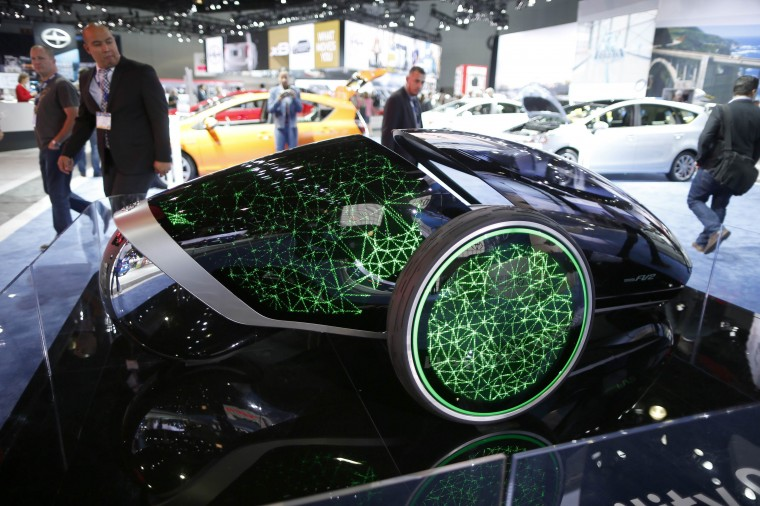 People view a Toyota Future Mobility Concept car at the 2014 Los Angeles Auto Show in Los Angeles, California November 20, 2014. (Lucy Nicholson/Reuters)