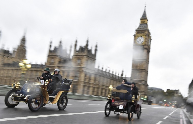 Motorists cross Westminster Bridge as they participate in the annual London to Brighton Veteran Car Run, in London. The annual run is now in its 118th year and takes place on the first Sunday of every November and commemorates the Emancipation Run of 14 November 1896 which celebrated the passing into law of the Locomotives on the Highway Act. The organizers claim it as the longest running motoring event in the world. (Toby Melville/Reuters)