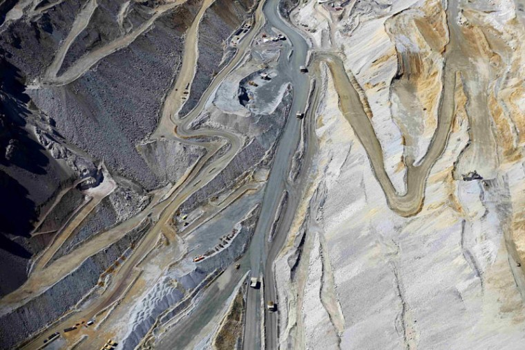 An aerial view of roads as mining trucks travel along at CODELCO'S Andina copper mine at Los Andes Mountain range, near Santiago city, November 17, 2014. The rock glaciers of the Chilean central zone, a huge source of water for the basins of the capital, are said to be threatened by the environmental impacts of hydroelectric and mining projects, according to environmental activists Greenpeace. (Ivan Alvarado/Reuters)
