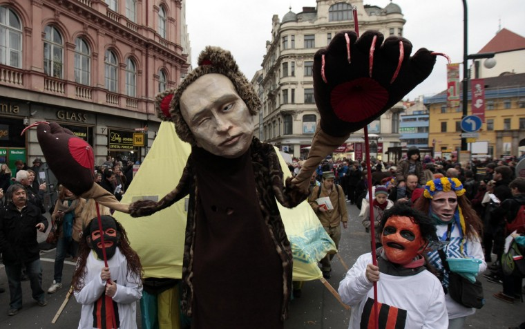 People, one wearing a mask depicting Russian President Vladimir Putin, march through the city center to commemorate the 25th anniversary of the Velvet Revolution in Prague. Czech Republic marks the anniversary of the 1989 Velvet Revolution, which led to the fall of the communist regime 25 years ago, on Monday. (David W Cerny/Reuters)