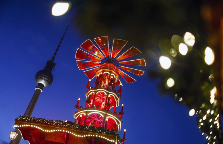 A Christmas pyramid is pictured next to the television tower at the Christmas market at Alexanderplatz square in Berlin November 24, 2014. (Hannibal Hanschke/Reuters)