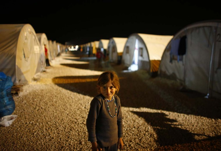 A Kurdish refugee girl from the Syrian town of Kobani stands in a refugee camp in the border town of Suruc, Sanliurfa province November 19, 2014. (Osman Orsal/Reuters)