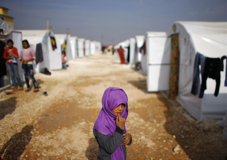 A Kurdish refugee girl from the Syrian town of Kobani is seen in a refugee camp in the Turkish border town of Suruc, Sanliurfa province November 13, 2014. (Osman Orsal/Reuters)
