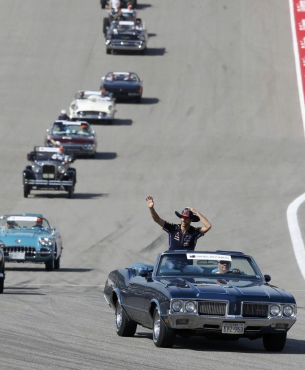 Red Bull Formula One driver Daniel Ricciardo of Australia is driven around the track in a vintage Oldsmobile convertible during ceremonies prior to the start of the F1 United States Grand Prix in Austin, Texas. (Adrees Latif/Reuters)