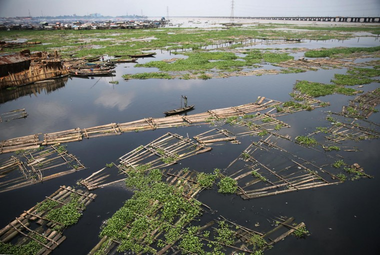 A raft of logs floats through the Lagos Lagoon September 25, 2014. Wood, a form of biomass, is the sole source of energy for hundreds of millions of Africans who lack access to modern sources of power, and logging, both legal and illegal, remains a lucrative business that has contributed to the rapid shrinking of Africaís rainforests and woodlands. Nigeria lost just over 2 million hectares of forest annually between 2005-2010 driven by agricultural expansion, logging and infrastructure development, according to U.N. data. It is also among the biggest users of solid fuel for cooking, with over 120 million Nigerians relying on firewood and charcoal for their cooking needs, according to the International Energy Agency. (Akintunde Akinleye/Reuters)