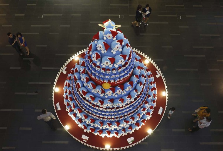 People take photos of a Christmas tree made up of Japanese Manga character Doraemon at a shopping mall in the central business district in Singapore November 24, 2014. (Edgar Su/Reuters)