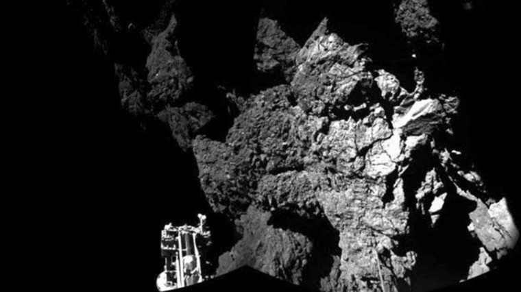 A probe named Philae is seen after it landed safely on a comet, known as 67P/Churyumov-Gerasimenko, in this CIVA handout image released November 13, 2014. The European probe that landed on the comet in a first for space exploration is safely anchored on the surface despite technical problems, pictures beamed half a billion kilometres (300 million miles) back to Earth showed on Thursday. The lander, named Philae, was launched from its mothership Rosetta on Wednesday as it orbited comet 67P/Churyumov-Gerasimenko, the climax of a 10-year-odyssey for the European Space Agency (ESA). (ESA/Rosetta/Philae/CIVA/Handout via Reuters)