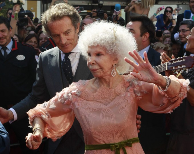 Spain's Duchess of Alba Cayetana Fitz-James Stuart y Silva (R) dances flamenco beside her husband Alfonso Diez outside Las Duenas Palace after their wedding in Seville in this October 5, 2011 file photo. Spain's Duchess of Alba, one of Europe's wealthiest aristocrats, died on November 20, 2014, aged 88, after a short illness, media said. The owner of fabulous palaces and priceless works of art, Cayetana Fitz-James Stuart y Silva, known as 'Cayetana', was known for her flamboyant lifestyle and was the world's most titled person, according to the Guinness Book of Records. (Javier Diaz/Files/Reuters)