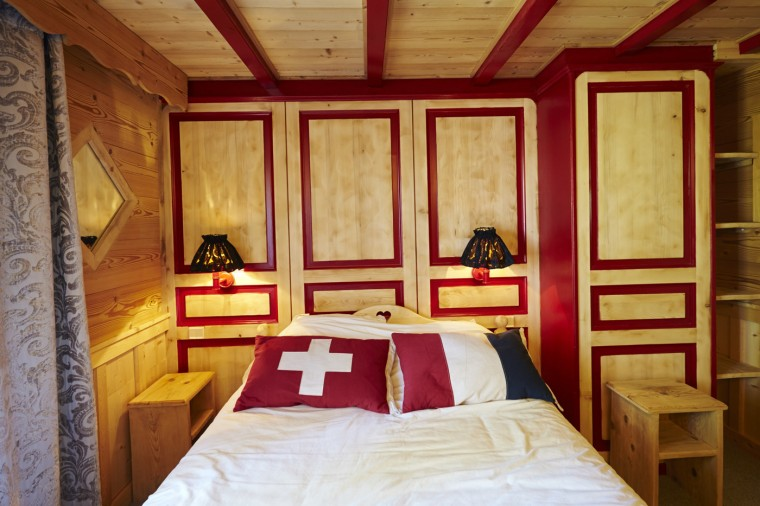 A bed lies directly across the French-Swiss border, with the head of the bed in Switzerland and the foot of the bed in France at the Hotel Arbez in Les Rousses April 23, 2014.