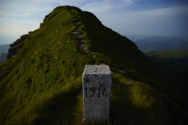A marker stands on a ridge dividing Switzerland (L) and Italy (R) at the Monte Generoso near Mendrisio May 11, 2014.