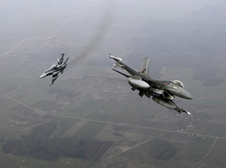 Portuguese Air Force fighter F-16 (R) and Canadian Air Force fighter CF-18 Hornet patrol over Baltics air space, from the Zokniai air base near Siauliai November 20, 2014. NATO pilots practised scrambling their jets on Wednesday, in preparation for potential further unauthorised Russian jets encountered on Baltic patrols. The flight drills were part of theNATO Baltic Air Policing Mission, a collective defence project which has been running for a decade. (Ints Kalnins/Reuters)