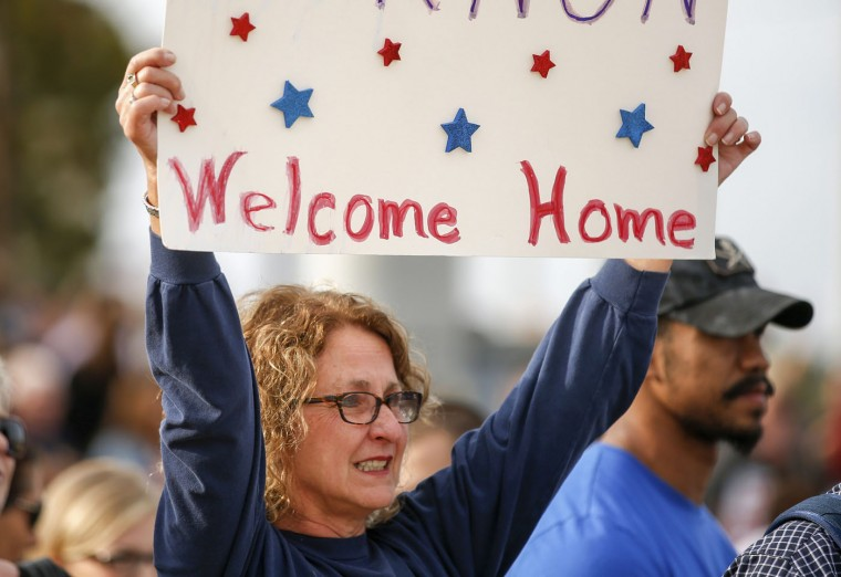 Jackie Garnon waves a sign as she waits for her son, a paratrooper with the 1st Brigade Combat Team, 82nd Airborne Division, to return home from Afghanistan at Pope Army Airfield in Fort Bragg, North Carolina November 5, 2014. Approximately 300 troops arrived home after being deployed since February 2014, according to the military. (Chris Keane/Reuters)