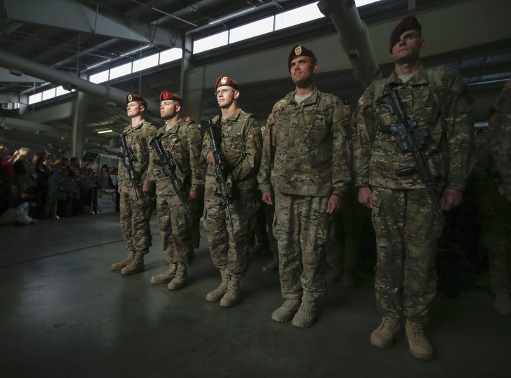 Paratroopers with the 1st Brigade Combat Team, 82nd Airborne Division, stand at attention after returning home from Afghanistan at Pope Army Airfield in Fort Bragg, North Carolina November 5, 2014. Approximately 300 troops arrived home after being deployed since February 2014, according to the military. (Chris Keane/Reuters)