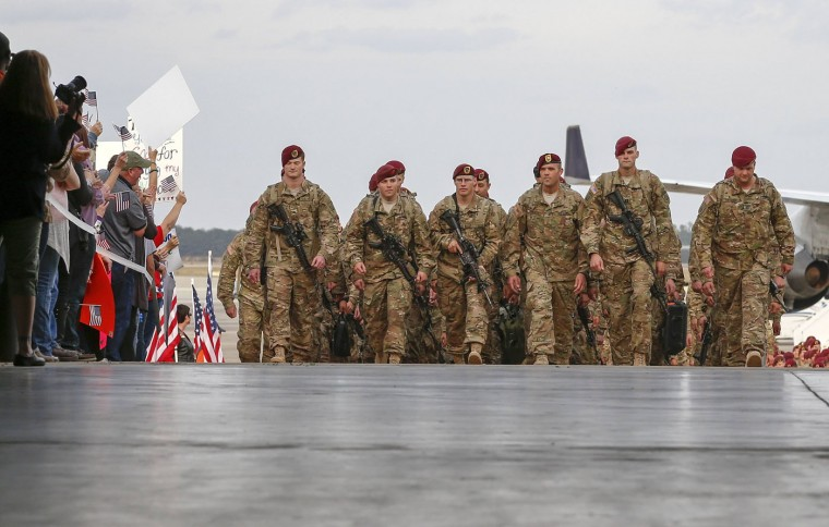 Paratroopers with the 1st Brigade Combat Team, 82nd Airborne Division, march up the ramp as they return home from Afghanistan at Pope Army Airfield in Fort Bragg, North Carolina November 5, 2014. Approximately 300 troops arrived home after being deployed since February 2014, according to the military. (Chris Keane/Reuters)