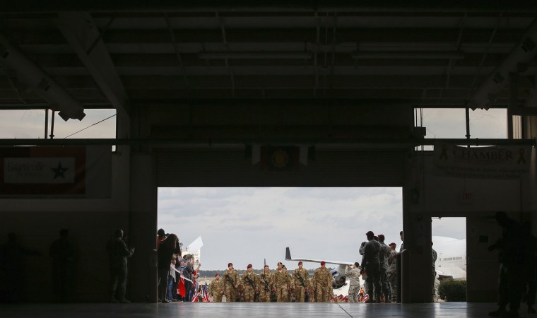 Paratroopers with the 1st Brigade Combat Team, 82nd Airborne Division march up the ramp as they return home from Afghanistan, at Pope Army Airfield in Fort Bragg, North Carolina November 5, 2014. Approximately 300 troops arrived home after being deployed since February 2014, according to the military. (Chris Keane/Reuters)