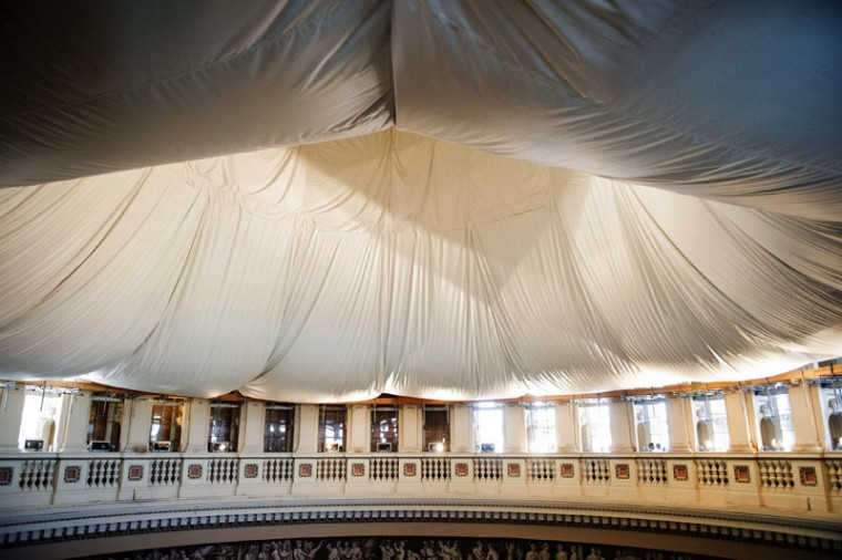 A doughnut shaped protective safety net hangs from the ceiling of the rotunda in the U.S. Capitol during a tour of the U.S. Capitol Dome Restoration Project in Washington, November 18, 2014. (Bill Clark/Pool/Reuters)
