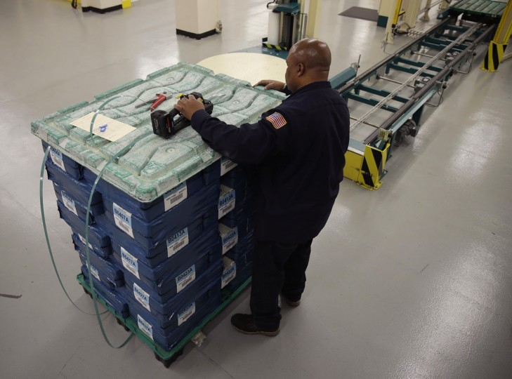 United States one dollar bills are loaded on a skid during production at the Bureau of Engraving and Printing in Washington November 14, 2014. This batch of currency is destined for the New York Federal Reserve Bank. (Gary Cameron/Reuters)