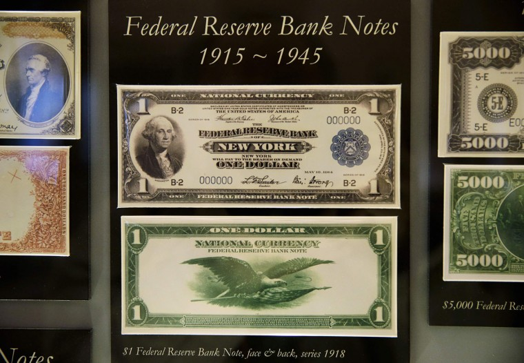 A display case shows 1918 historic United States Federal Reserve one dollar bank notes at the Bureau of Engraving and Printing in Washington November 14, 2014. (Gary Cameron/Reuters)
