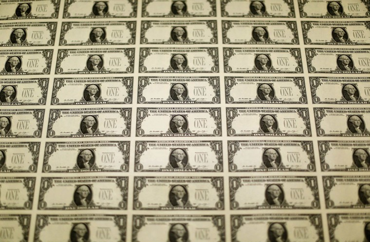 A sheet of the front side of United States one dollar bills is seen during production at the Bureau of Engraving and Printing in Washington November 14, 2014. (Gary Cameron/Reuters)