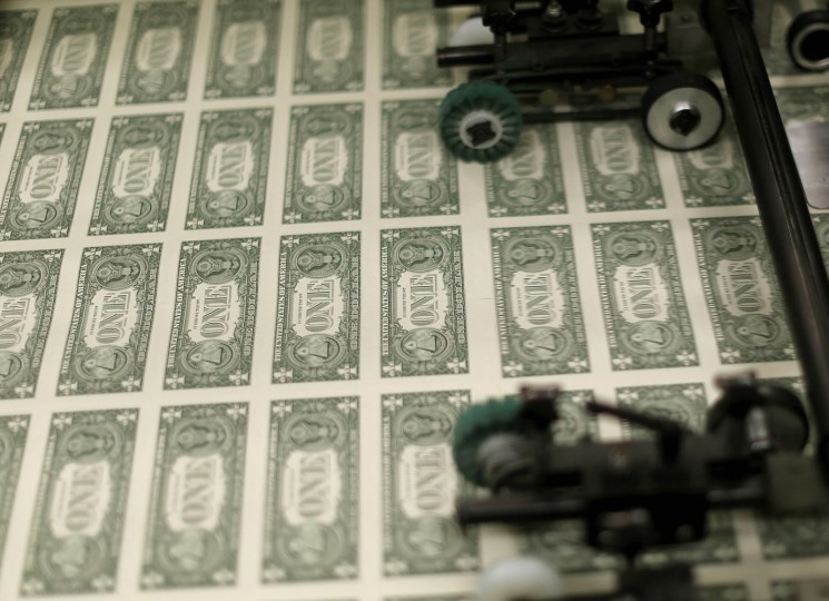Sheets of United States one dollar bills are seen during the production process at the Bureau of Engraving and Printing in Washington November 14, 2014. (Gary Cameron/Reuters)