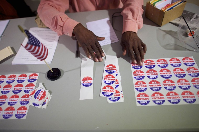 A majority inspector arranges 'I Voted Today!' stickers at registration on U.S. midterm election day morning at Holmes School Senior Center in Philadelphia, Pennsylvania, November 4, 2014. (Mark Makela/Reuters)