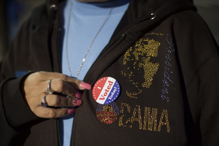 Tina Spann, 49, displays a 'I Voted Today' sticker on her sweatshirt with a President Barack Obama logo, after she greeted Democrat challenger for Pennsylvania Governor Tom Wolf, on election day morning in Philadelphia, Pennsylvania November 4, 2014. (Mark Makela/Reuters)