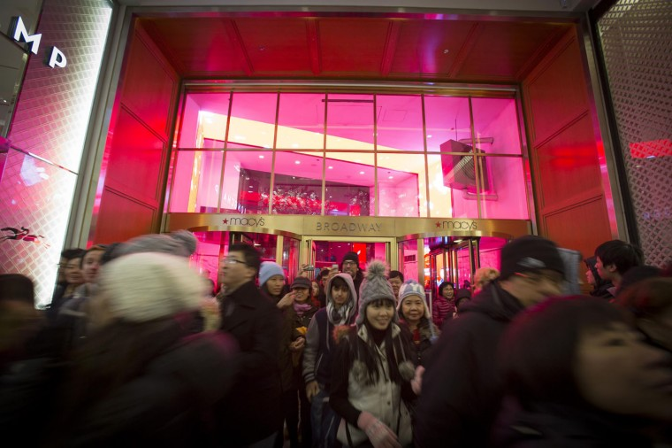 Shoppers enter Macy's to kick off Black Friday sales in New York November 27, 2014. Select stores opened Thursday to kick off the Black Friday sales, with the Friday after Thanksgiving typically being the busiest shopping day of the year in the U.S. (Andrew Kelly/Reuters)