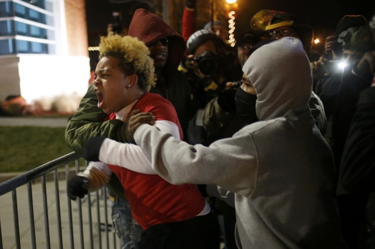 A woman approaches the barricade to confront the police outside the Ferguson Police Department in Ferguson, Missouri, November 24, 2014. A St. Louis County grand jury chose not to indict Ferguson policeman Darren Wilson in the Aug. 9 shooting death of Michael Brown, 18, St. Louis County Prosecutor Bob McCulloch said. (Adrees Latif/Reuters)