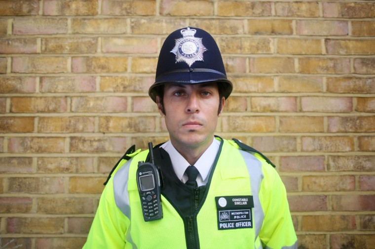 """Police constable Ben Sinclair wearing his Metropolitan Police uniform with high visibility jacket, in London. In Britain, """"lethal or potentially lethal force should only be used when absolutely necessary in self-defence, or in the defence of others against the threat of death or serious injury"""". Picture taken October 9. (Paul Hackett/Reuters)"""