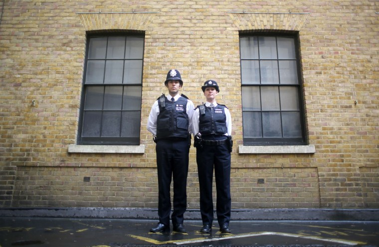 """Police constables Ben Sinclair and Karen Spencer wearing their Metropolitan Police beat uniforms, in London. In Britain, """"lethal or potentially lethal force should only be used when absolutely necessary in self-defence, or in the defence of others against the threat of death or serious injury"""". Picture taken October 9. (Paul Hackett/Reuters)"""