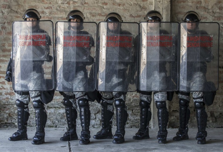 Serbian gendarmerie officers inside their base in Belgrade October 9, 2014. In Serbia, police may use measures ranging from batons to special vehicles, water cannon and tear gas on groups of people who have gathered illegally and are behaving in a way that is violent or could cause violence, but they may use firearms only when life is endangered. Picture taken October 9. (Marko Djurica/Reuters)