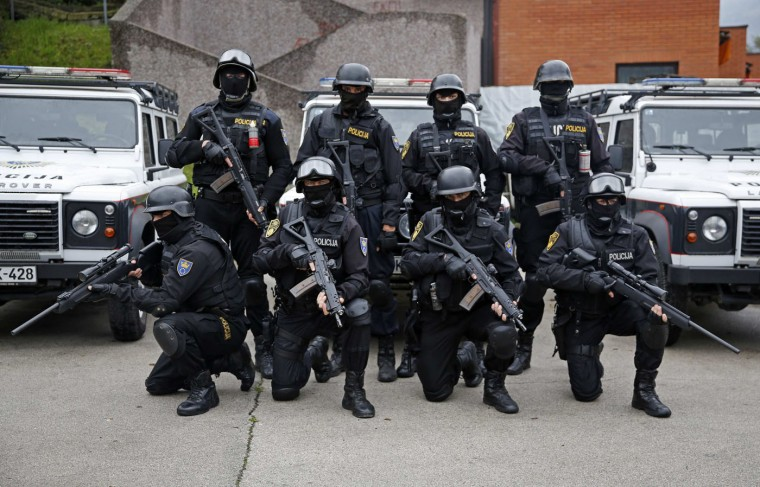 """Members of Special Police Support Unit in front of their base in central Bosnian town of Zenica. In Bosnia, police are permitted to use force ranging from batons to chemical irritants, water cannon, """"binding agents, special firearms and explosive devices"""", following a warning, but only when other methods of control have proved ineffective, and not against the young, old or disabled unless these use firearms. The method must be """"proportional to the resistance or violence coming from the person on whom the force is used"""". Picture taken October 3. (Dado Ruvic/Reuters)"""