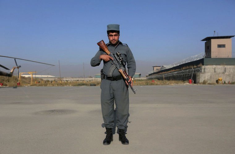 """Afghan policeman Zabiullah, 24, poses for photo in Kabul. In Afghanistan, """"the police can use weapons or explosives against a group of people only if they it has ... disturbed security by means of arms, and if the use of other means of force ... has proved ineffective"""". Afghan police are required to give no fewer than six warnings - three verbal and three warning shots - before using force in this situation. Picture taken October 2. (Omar Sobhani/Reuters)"""