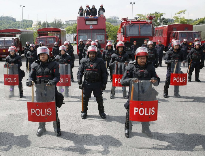 Malaysia's public order police, the Federal Reserve Unit (FRU), wearing riot control equipment at their headquarters in Kuala Lumpur. In Malaysia, the FRU are only permitted to use firearms in cases where the protesters are using firearms. Firearms have not been used in the 59 years since the FRU was formed. Picture taken November 20. (Olivia Harris/Reuters)