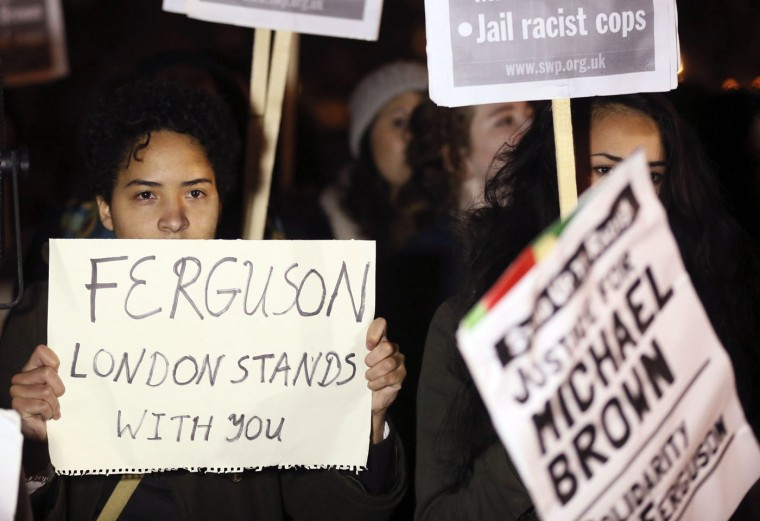 Demonstrators take part in a protest to show solidarity with the family of black teenager Michael Brown, outside the American Embassy in London November 26, 2014. 18-year-old Michael Brown was shot to death by policeman Darren Wilson on Aug. 9 in Ferguson, Missouri. The shooting has highlighted the often-tense nature of U.S. race relations and the strains between black communities and police. REUTERS/Paul Hackett