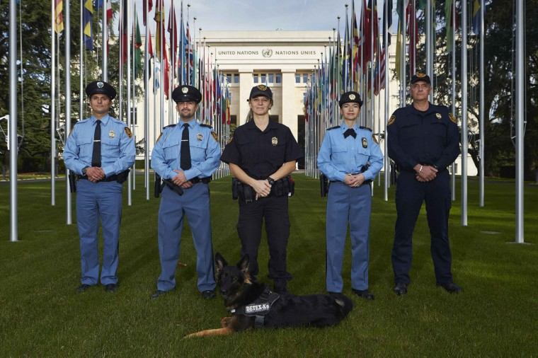 """Members of the United Nations security forces pose in front of the U.N. European headquarters in Geneva. U.N. police in Geneva follow the local cantonal police rules, which say that """"the use of weapons, proportionate to the circumstances, is authorised as a last resort"""" but should """"avoid serious injury whenever possible"""", and that """"the use of a firearm is preceded by a warning """"if circumstances permit"""". The United Nations Office in Geneva is considered ex-territorial and is not under the jurisdiction of the host country Switzerland. Picture taken October 20. (Denis Balibouse/Reuters)"""