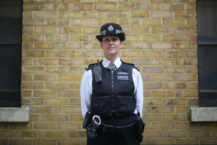 """Police constable Karen Spencer poses for a photograph wearing her Metropolitan Police beat uniform, in London. In Britain, """"lethal or potentially lethal force should only be used when absolutely necessary in self-defence, or in the defence of others against the threat of death or serious injury"""". Picture taken October 9. (Paul Hackett/Reuters)"""