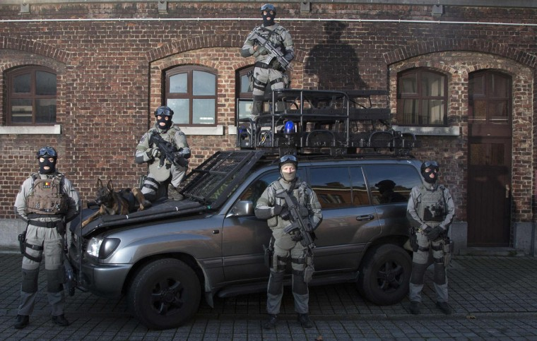 Members of Belgium's special forces at their headquarters in central Brussels. Human rights monitors say police in Belgium are legally entitled to use proportionate force, after a warning, where there is no other means to achieve a legitimate objective. They say police may use firearms in self-defence, to confront armed perpetrators, or in defence of persons or key facilities, but never for crowd control. Picture taken November 24. (Yves Herman/Reuters)